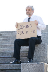 Fired man. Depressed senior man in formalwear holding poster Loo