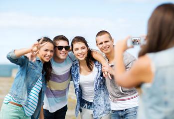 teenagers taking photo outside