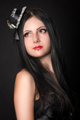 Beautiful girl portrait studio shot. Gothic style clothing, very