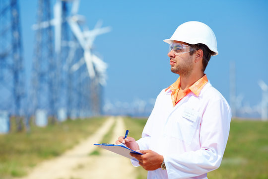 researcher analyzes readouts on wind power station