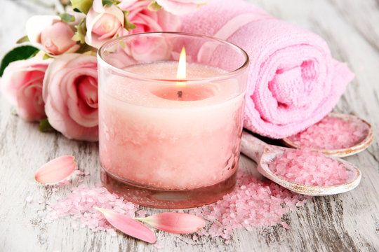 Beautiful spa setting with pink candle and flowers