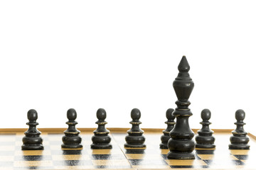 Black king and pawns on chess board