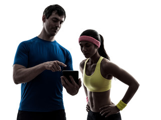 Wall Mural - woman exercising fitness  man coach using digital tablet