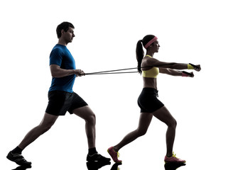 Wall Mural - woman exercising fitness resistance  rubber band with man coach