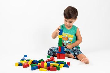 boy builds a tower