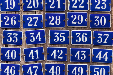 Set of incrementing house number plates