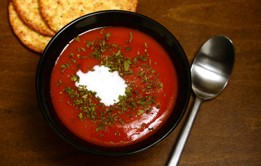 tomato soup on a rustic wooden background