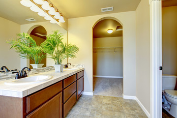 New home bathroom with shower and bath.