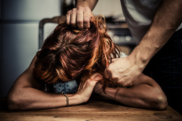 man physically abusing his girlfriend