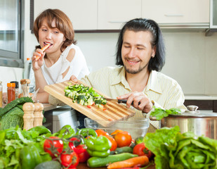Cute couple preparing a meal of vegetables