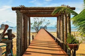 Wooden jetty leading to sea of Koh Mak island