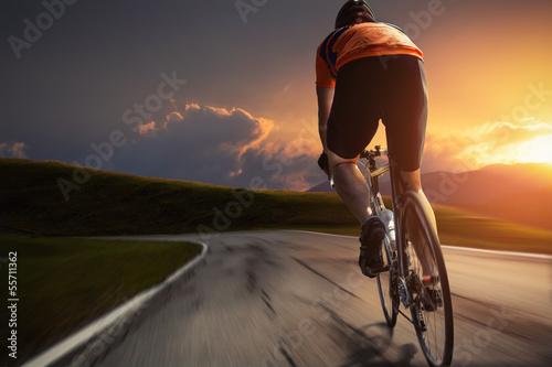 Wall mural Sunset Biking