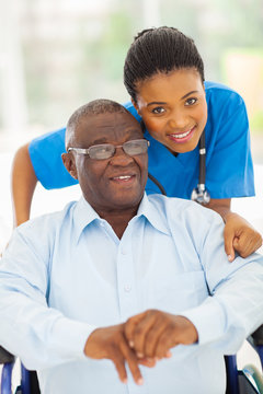 elderly african american man and caring young caregiver