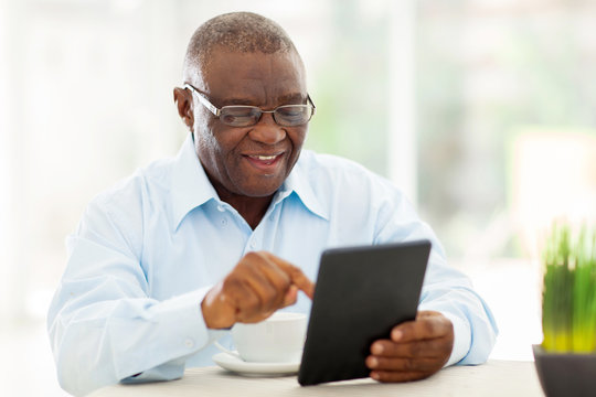 senior african american man using tablet computer at home