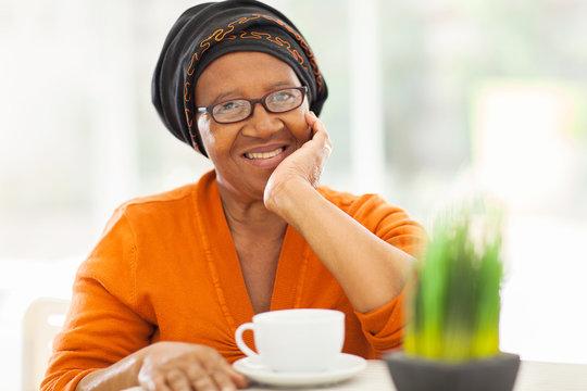 senior african woman having tea