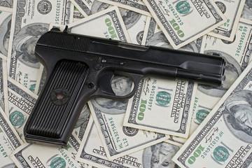Handgun On American Hundred Dollar Bills