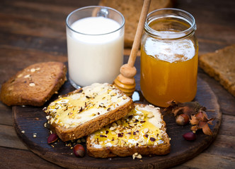 Healthy breakfast - bread, butter and honey