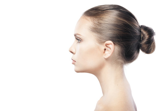 portrait of beautiful young woman with clean skin isolated on wh