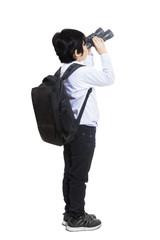 Business kid using binoculars - isolated