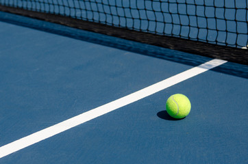 Tennis Ball on Court with Net