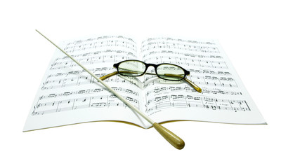 Baton and glasses on music score