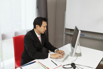 Asian businessman working in his room