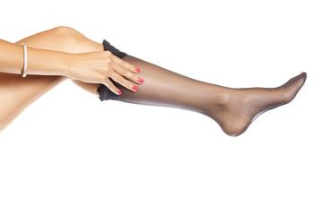 woman putting on nylon stockings