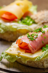Fresh sandwich made of chive, ham lettuce and cheese