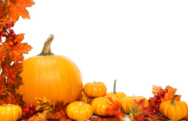 Autumn corner border or frame with leaves and pumpkins