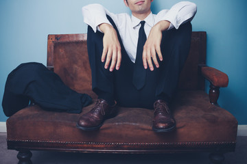 Businessman relaxing after long day at work