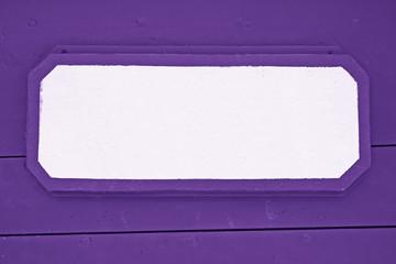 Wooden signboard on Purple planks background