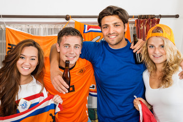 Happy Soccer Fans Standing Together At Home