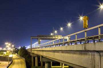Highway with emergency telephone at night