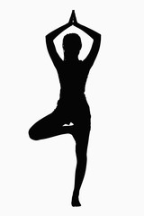 Silhouette of woman doing yoga pose.