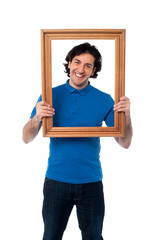 Man holding wooden picture frame