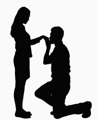 Silhouette of man on one knee, kissing woman's hand.