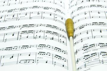 Baton on music score