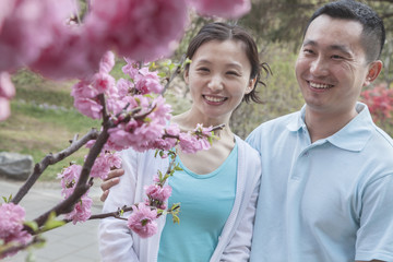 Couple looking at cherry blossoms.