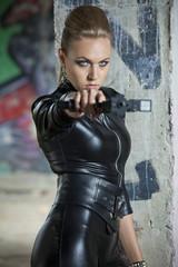 serious woman with gun