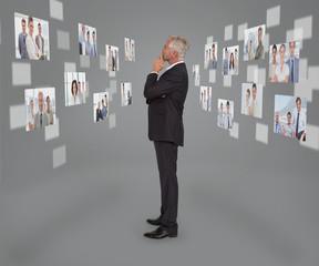 Mature businessman looking at digital interface