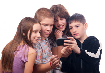 Teenage boy showing digital content to friends