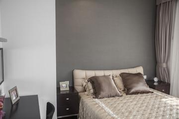 Bright, modern bedroom with beige bedspread.