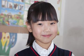 Portrait of schoolgirl in classroom, Beijing, China