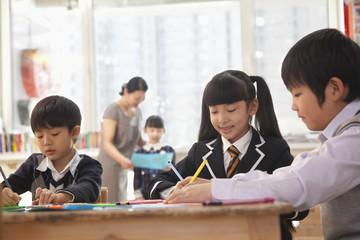 School children drawing during art class, Beijing