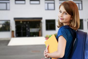 Back to school - portrait of  lovely schoolgirl
