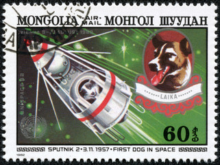 stamp printed by Mongolia, shows Sputnik 2 and Laika