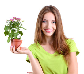 Beautiful girl with flower in pot isolated on white