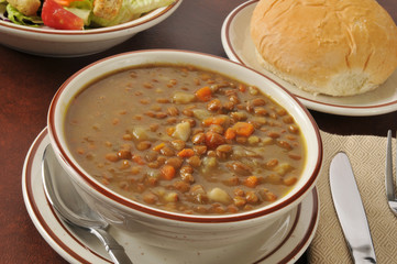 Lentil soup with salad and a roll