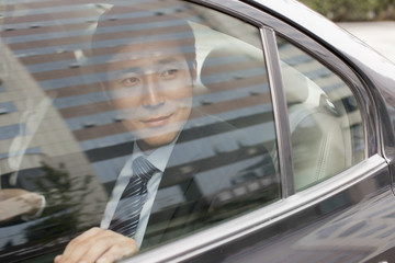 Smiling Businessman in Car Back
