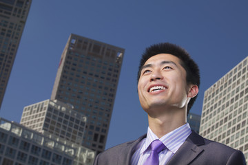 Portrait of young businessman outside in the business district, Beijing